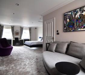 Mayfair interior design - Luxury Bedroom featuring bespoke lighting and MF Husain artwork