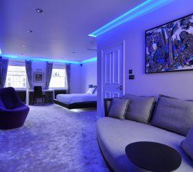 Mayfair - Luxury Bedroom featuring bespoke mood lighting and MF Husain artwork